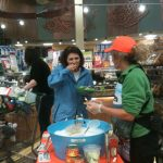 Serving salmon sample at Whole Foods Market