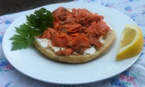 Redhead wild Alaska sockeye salmon, straight from the waters of the great Bristol Bay, on a bagel