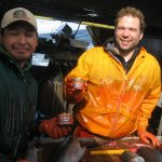 Remo Lotscher and Andy Zuanich on rocking boat with Canned Salmon