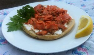 A very vibrant red sockeye salmon on a bagel